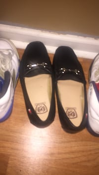 two pairs of black and white leather flats Metairie, 70003