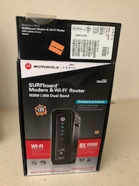 Black motorola surfboard modem router with boxx
