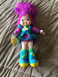 girl wearing blue and pink dress doll 551 km