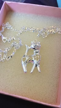 Silver necklace with cat  pendant.