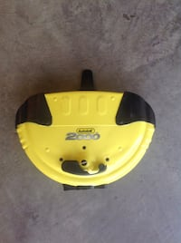 Yellow and black plastic steering wheel lock with key. Red Deer, T4R 3B1