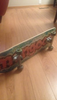 Red and teal mongoose skateboard Calgary, T2K 4Z7