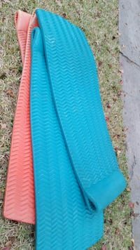 two orange and blue car mats