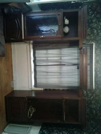 brown wooden TV hutch with flat screen television Shreveport, 71108
