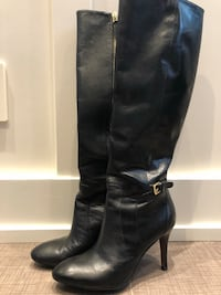 pair of black leather knee-high boots Calgary, T3E 4L3
