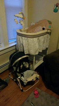 baby's brown and white bassinet Woonsocket, 02895