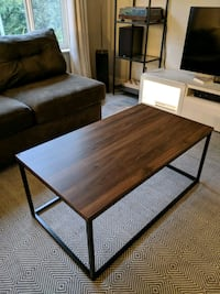 Modern wood and steel frame coffee table