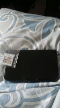 3ds xl with super smash bros 4 and a charger