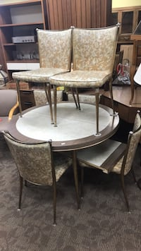 round brown wooden table with four chairs dining set 22 mi