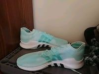pair of green-and-white Nike running shoes Kitchener, N2C 2S6