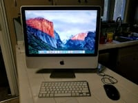 silver iMac with Apple Magic Keyboard and Mouse