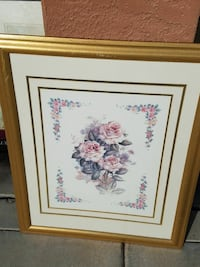 brown wooden framed picture  of flowers