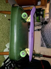 purple, yellow, and green penny board barely used 397 mi