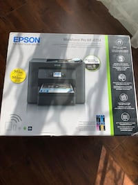Brand new WiFi printer (never opened) -still on the box  -bought new