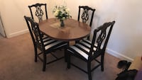 round brown wooden table with four chairs dining set Alexandria, 22304