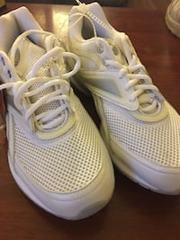 pair of white-and-gray Nike running shoes 27 km