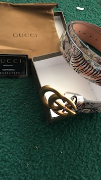white and black Gucci leather belt