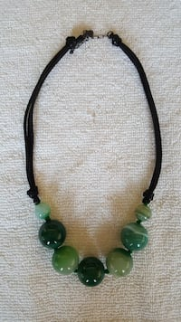 Bauble necklace on blk leather like string