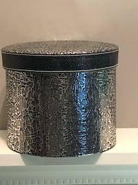 "Shiny silver festive round 'box' 7 1/2"" high X 9.4"" wide. Edmonton, T6L 6P5"