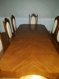 rectangular brown wooden table with four chairs dining set St. Catharines, L2S 3R7