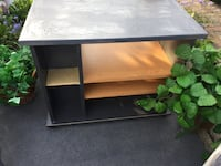 TV stand with shelves and storage front and left side. Stand is charcoal and light gray with wood colors. 27.5x16.5x22 Massillon, 44646