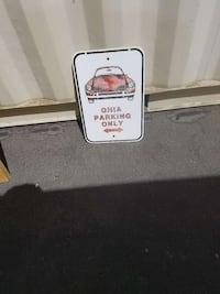 Ghia Parking Only signage