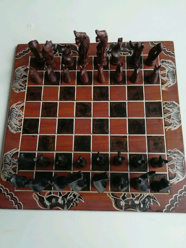 Black and Brown Chess Board a93c04ca-71e4-4ee9-94d4-adbc762120f3