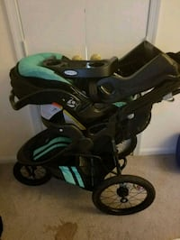 baby's black and green jogging stroller 29 mi