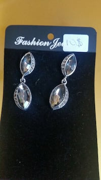 pair of silver-colored earrings with gemstones