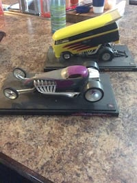 two yellow and purple die-cast cars