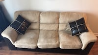 Tan and black suede 2 seater couch  576 km