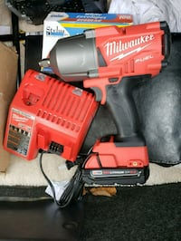 red and black Milwaukee cordless impact wrench Hyattsville, 20782