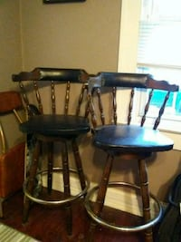 2 swivel tall leather seat and wood bar stools Indianapolis, 46217