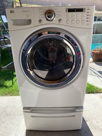 LG tromm front load gas dryer only with steam cycle and pedestal good condition Temecula, 92591