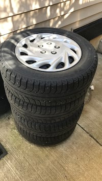 Gray 5-spoke car wheel with tire set Nanaimo, V9R 6H9