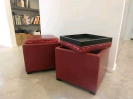 Two free red faux leather storage ottomans