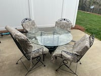 Round glasss patio set with cushions