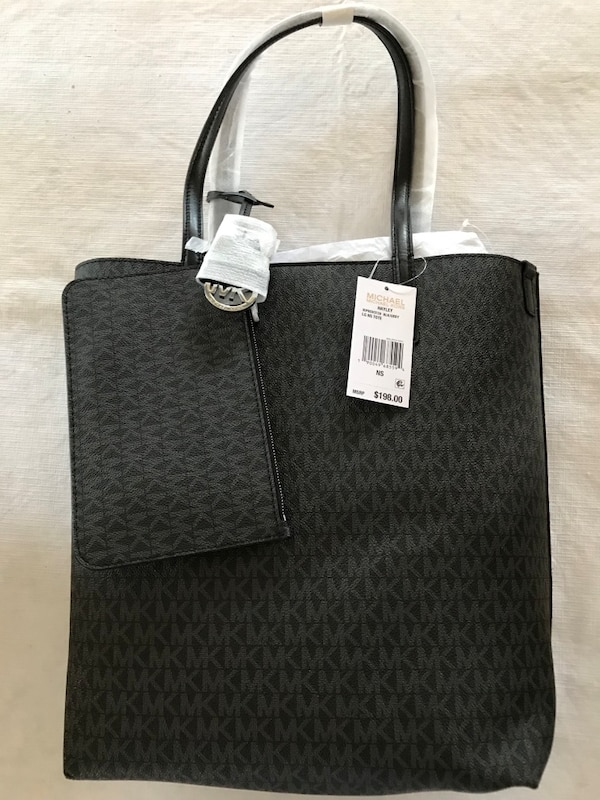 Used Black michael kors monogrammed leather tote bag for sale in Hampden 0e71d0e0a083