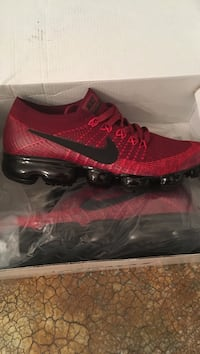 pair of black-and-red Nike low-top sneakers