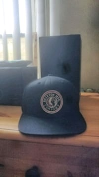 blue and white fitted cap Red Deer, T4P 2H7