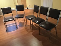 four black leather padded chairs Laval, H7K