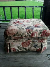 brown and red floral padded ottoman