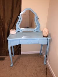 Blue wooden vanity table with himalayan salt lamp