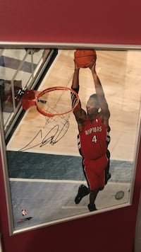 silver framed autographed basketball player photograph