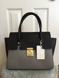 Woman's handbag gray and black with golden details.