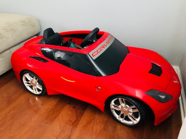 red and black ride-on toy car