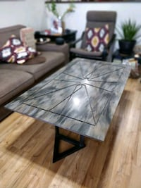 Coffee table made of corian stone and steel legs. Mesa, 85204
