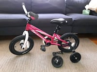 toddler's pink and black bicycle with training wheels 43 km
