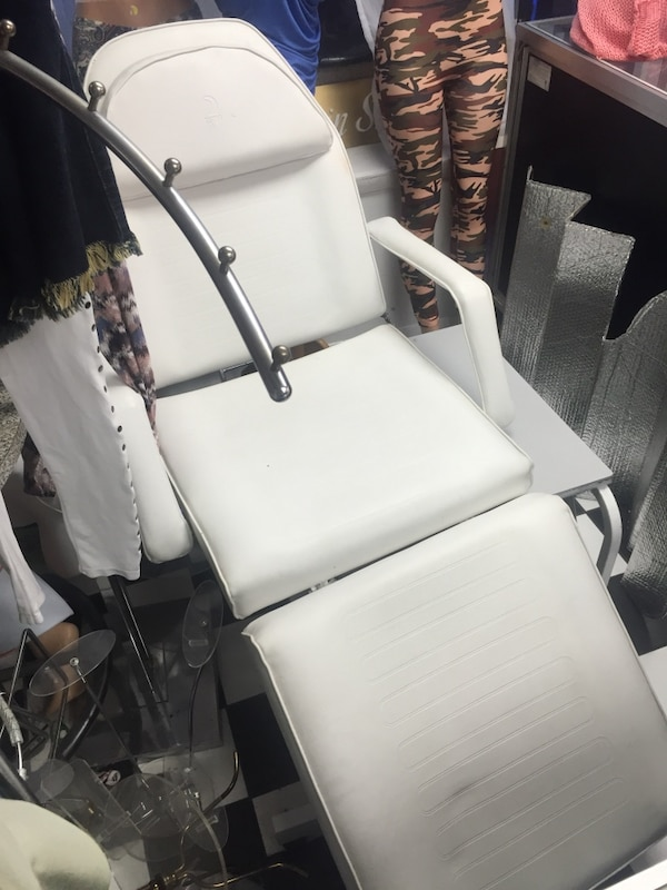 white and black metal armchair
