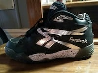 unpaired black and gray Reebok high-top sneaker